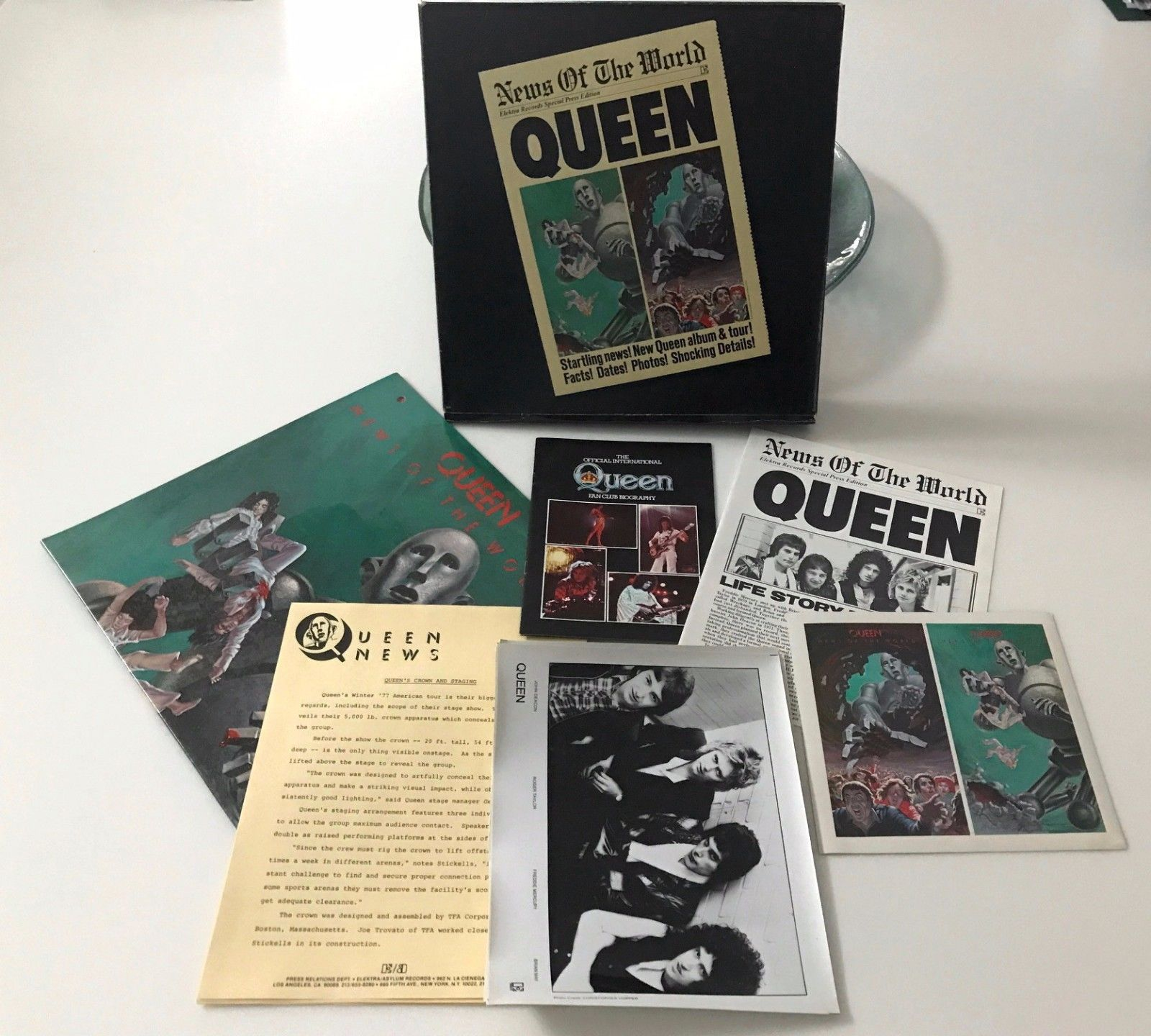 Popsike com queen news of the world press kit w lp pics